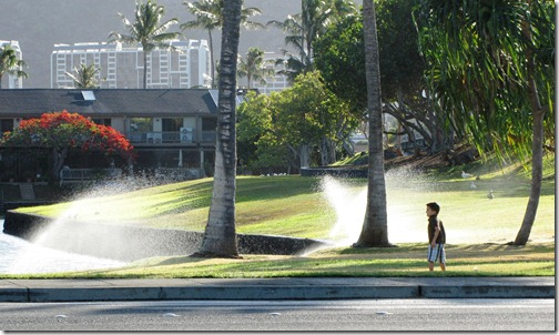 Boy and Sprinklers